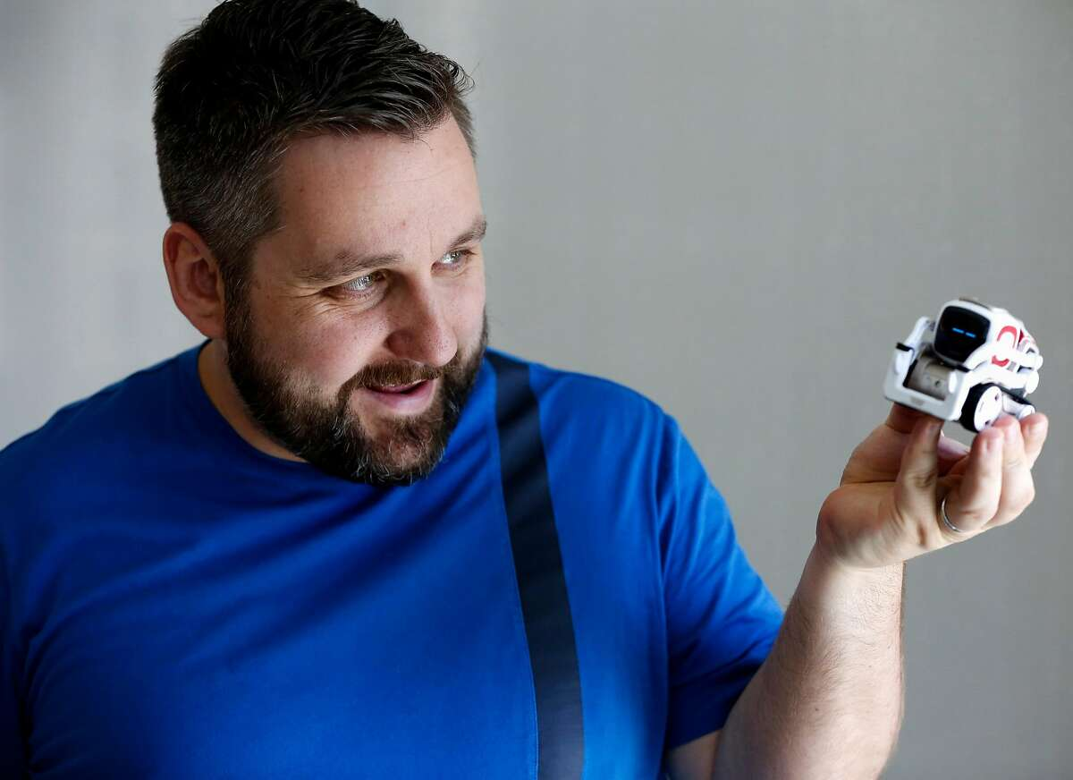 Hanns Tappeiner, president and co-founder of Anki, holds up toy robot Cozmo in Anki's offices in San Francisco, California, on Thursday, June 23, 2016.