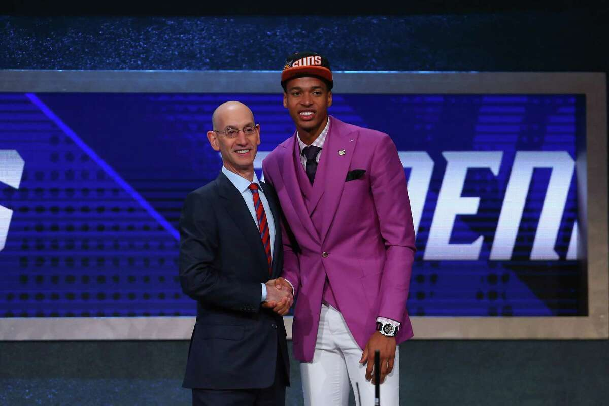 NEW YORK, NY - JUNE 23: Skal Labissiere shakes hands with Commissioner Adam Silver after being drafted 28th overall by the Phoenix Suns in the first round of the 2016 NBA Draft at the Barclays Center on June 23, 2016 in the Brooklyn borough of New York City. NOTE TO USER: User expressly acknowledges and agrees that, by downloading and or using this photograph, User is consenting to the terms and conditions of the Getty Images License Agreement.