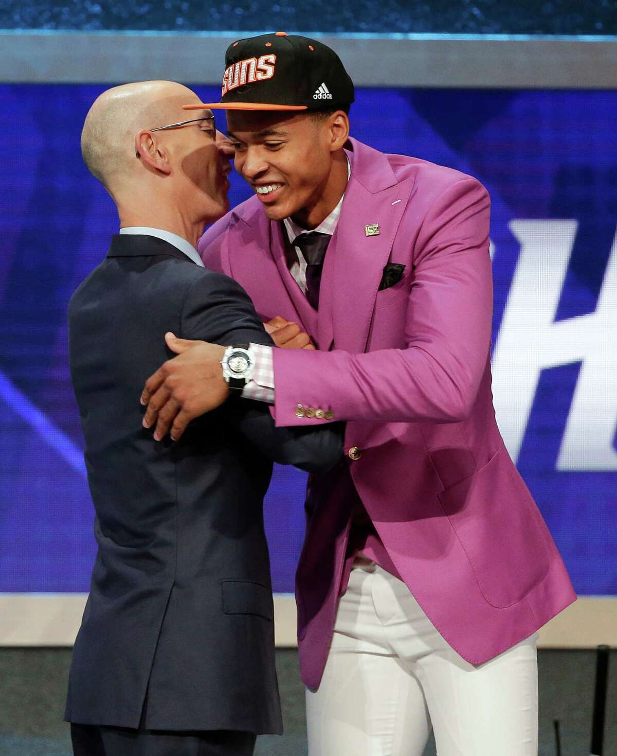 Skal Labissiere, right, is greeted by NBA Commissioner Adam Silver after being selected 28th overall by the Phoenix Suns during the NBA basketball draft, Thursday, June 23, 2016, in New York. (AP Photo/Frank Franklin II)