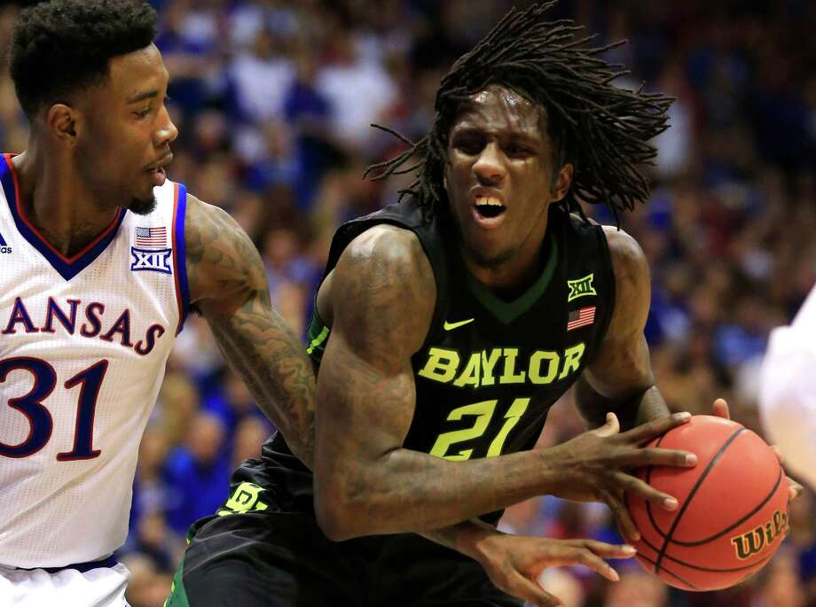 Baylor forward Taurean Prince (right) is covered by Kansas forward Jamari Traylor during the second half Lawrence, Kan., on Jan. 2, 2016. Photo: Orlin Wagner /Associated Press / AP