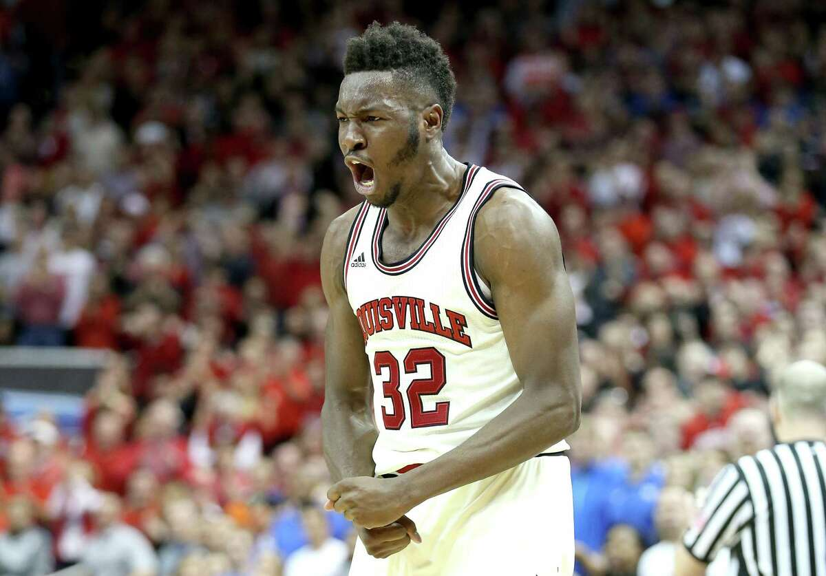 LOUISVILLE, KY - FEBRUARY 20: Chinanu Onuaku #32 of the Louisville Cardinals celebrates during the 71-64 win over the Duke Blue Devils at KFC YUM! Center on February 20, 2016 in Louisville, Kentucky.