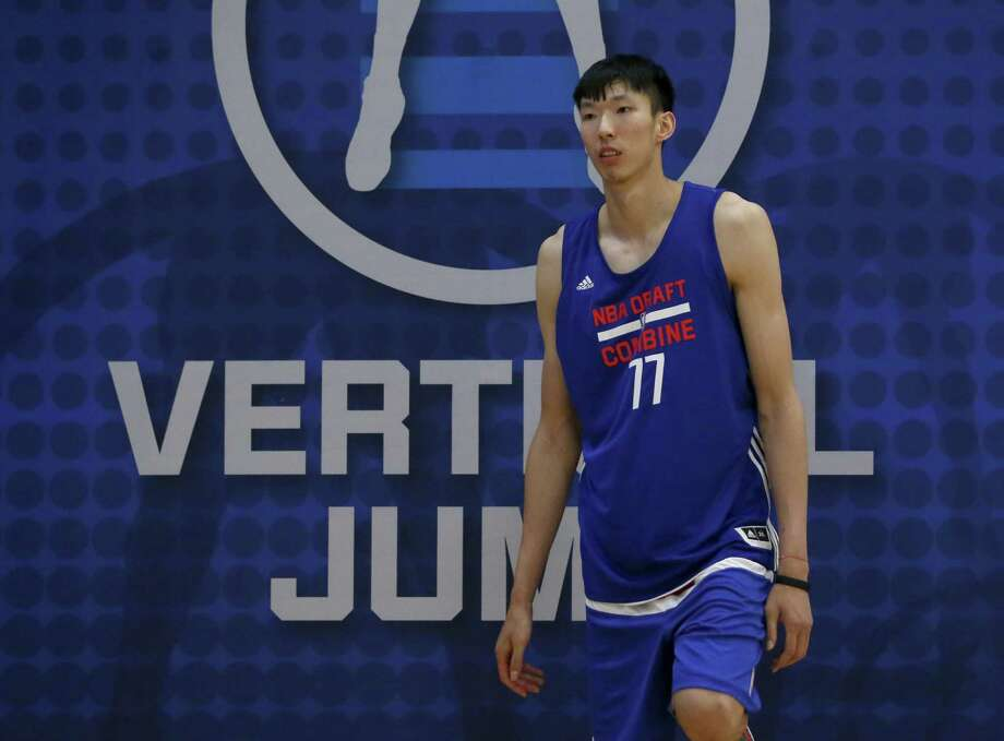 Zhou Qi, a Rockets second-round draft pick last June, is in Houston to train with the Rockets staff and potentially begin talks he hopes could lead to a contract with the team for next season. Photo: Charles Rex Arbogast, Associated Press / AP