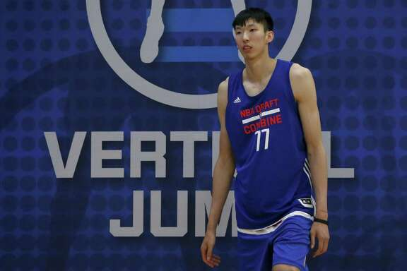 Zhou Qi, from China, participates in the NBA draft basketball combine Thursday, May 12, 2016, in Chicago. (AP Photo/Charles Rex Arbogast)