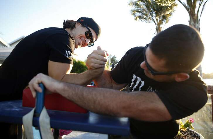 Professional arm wrestler Luke Kindt (left) practices with Mike Levin's at Levin's home in Novato, Calif., on Thursday, June 23, 2016.