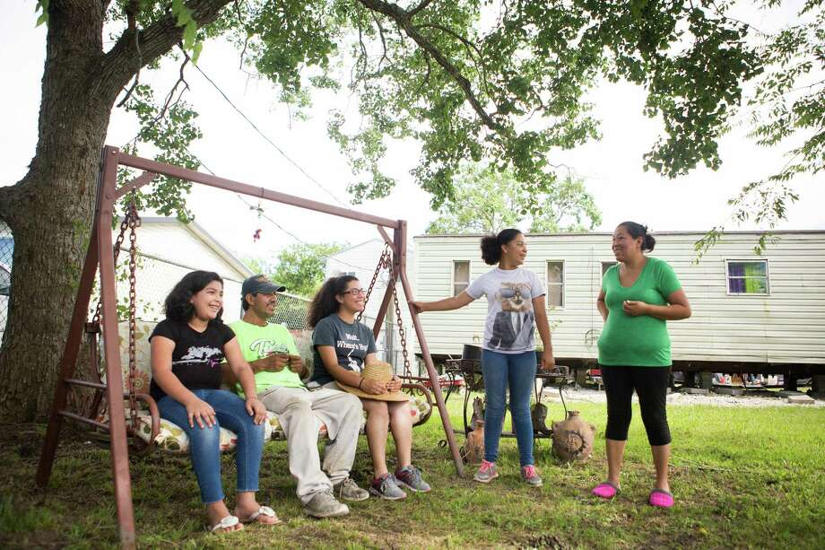 The Sosa family, including from left, Lupita, Jose, Erika, Rocio and Leticia, enjoy their new property in Alvin. The Supreme Court's tie vote blocked a plan that would have protected the parents from deportation.  Photo: Marie D. De Jesus, Staff / © 2016 Houston Chronicle