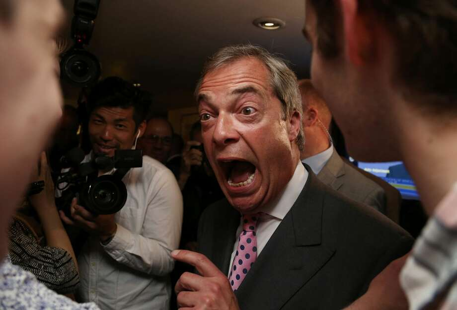 "Leader of the United Kingdom Independence Party (UKIP), Nigel Farage (C) reacts at the Leave.EU referendum party at Millbank Tower in central London on June 24, 2016, as results indicate that it looks likely the UK will leave the European Union (EU). Top anti-EU campaigner Nigel Farage said he was increasingly confident of victory in Britain's EU referendum on Friday, voicing hope that the result ""brings down"" the European Union. Photo: GEOFF CADDICK/AFP/Getty Images"