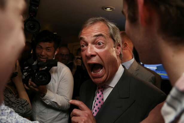 """Leader of the United Kingdom Independence Party (UKIP), Nigel Farage (C) reacts at the Leave.EU referendum party at Millbank Tower in central London on June 24, 2016, as results indicate that it looks likely the UK will leave the European Union (EU). Top anti-EU campaigner Nigel Farage said he was increasingly confident of victory in Britain's EU referendum on Friday, voicing hope that the result """"brings down"""" the European Union."""