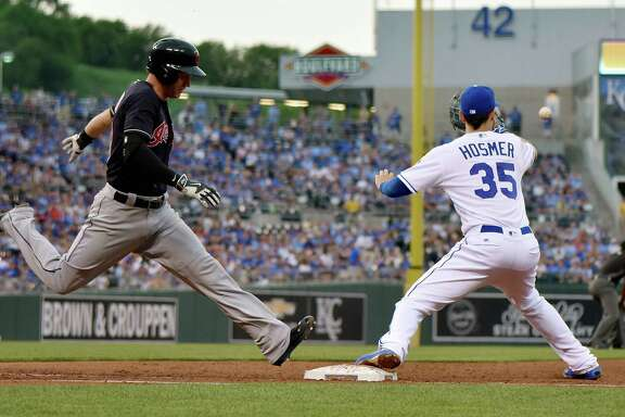 Kansas City's Eric Hosmer is one of the best defensive first basemen, but metrics show his defense as average. Cleveland Indians' Tyler Naquin reaches first before the throw to Kansas City Royals first baseman Eric Hosmer on an attempted double play during the fourth inning on Monday, June 13, 2016, at Kauffman Stadium in Kansas City, Mo. (John Sleezer/Kansas City Star/TNS)