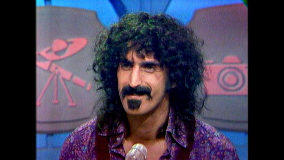 """Frank Zappa appears as the mystery guest on """"What's My Line?"""" in 1971, a scene that is part of the dcoumentary """"Eat That Question: Frank Zappa in His Own Words."""" Photo: Sony Pictures Classics"""