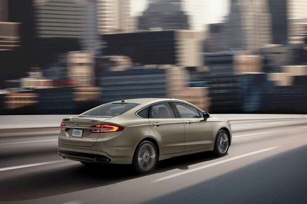 The top-of-the-line 2017 Fusion Platinum's standard features include power moonroof, universal garage door opener, rear spoiler, reverse sensing system, adaptive cruise control and polished 19-inch wheels.