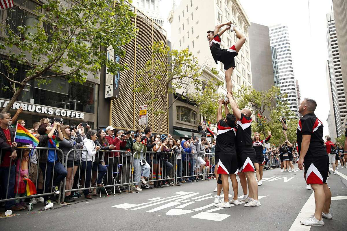 """Cheer SF members perform during the """"Equality Without Exception"""" SF Pride Parade down Market Street in San Francisco, Calif., on Sunday, June 28, 2015."""