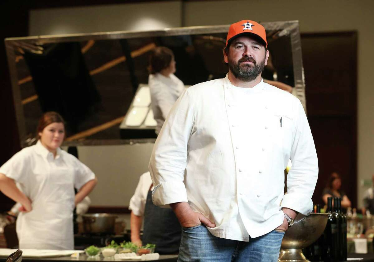 Bryan Caswell, of Reef, poses for a photo at Bon Vivant