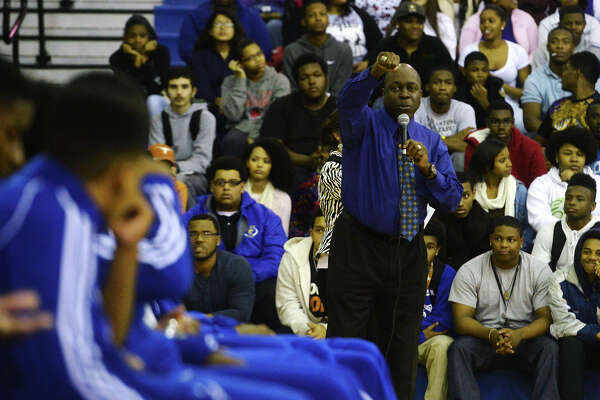 Rodney Saveat shows off a championship ring to Ozen basketball players during Tuesday's pep rally. Ozen High School hosted a pep rally Tuesday before seeing the Panthers basketball team off to the championships in San Antonio. Photo taken Tuesday 3/10/15 Jake Daniels/The Enterprise
