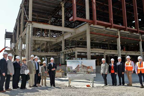 Members of the Albany Convention Center Authority, partners and dignitaries pose for a photo after a hard hat tour of construction progress at the Capital Center Friday June 24, 2016 in Albany, NY.  (John Carl D'Annibale / Times Union)