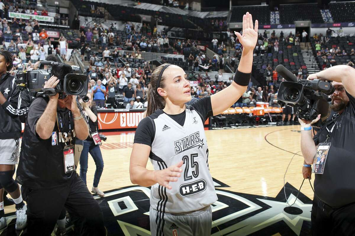 San Antonio Stars' Becky Hammon waves to fans after the game with the Minnesota Lynx Saturday Aug. 23, 2014 at the AT&T Center. The Lynx won 94-89. Hammon, who is retiring, will become the first woman to serve as a full-time NBA assistant coach with the Spurs.