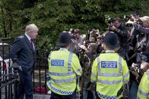 Boris Johnson, former mayor of London, speaks to the media as he leaves his home following the European Union (EU) referendum membership vote results in London, U.K., on Friday, June 24, 2016. The U.K. voted to quit the European Union after more than four decades in a stunning rejection of the continent's postwar political and economic order, prompting Prime Minister David Cameron to resign and sending shock waves around global markets. Photographer: Harry Page/Bloomberg