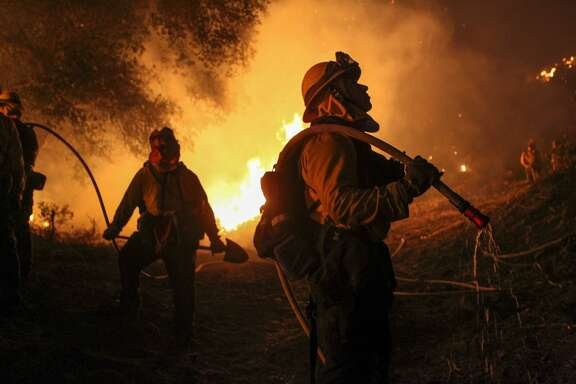 Firemen work to contain the 6,000 acre Border Fire in eastern San Diego County, California June 21, 2016.