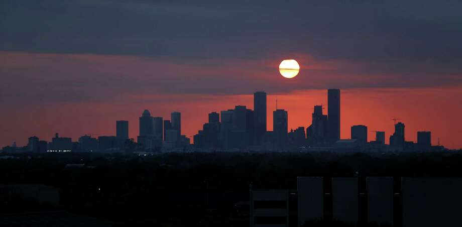 The sun sets behind the Houston skyline viewed from the east side of town over the ship channel from 610, Wednesday, May 11, 2016, in Houston. ( Mark Mulligan / Houston Chronicle ) sunset, downtown, Houston, skyline, silhouette Photo: Mark Mulligan, Houston Chronicle / © 2016 Houston Chronicle