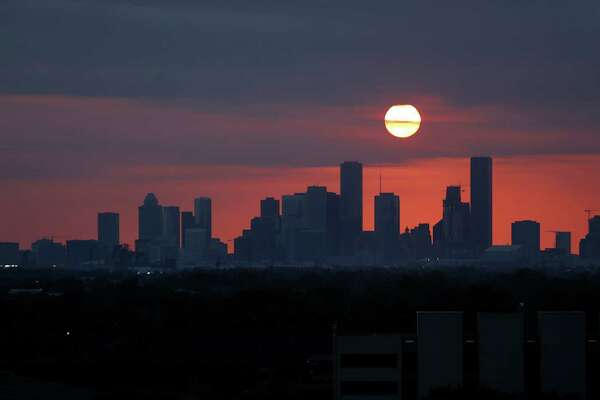 The sun sets behind the Houston skyline viewed from the east side of town over the ship channel from 610, Wednesday, May 11, 2016, in Houston. ( Mark Mulligan / Houston Chronicle ) sunset, downtown, Houston, skyline, silhouette