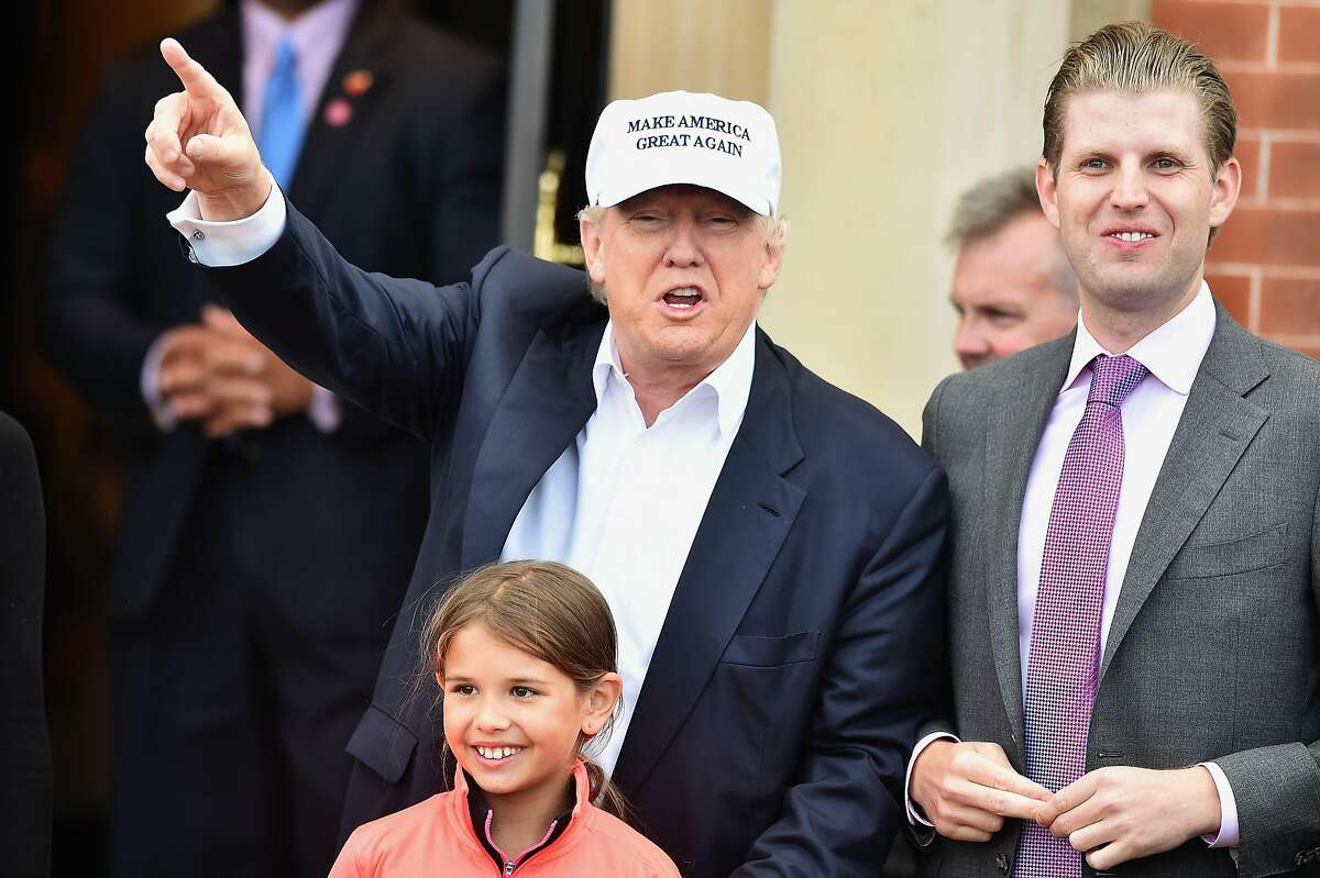 AYR, SCOTLAND - JUNE 24: Presumptive Republican nominee for US president Donald Trump, with son Eric Trump (R) and granddaughter Kai Trump, arrive at his Trump Turnberry Resort on June 24, 2016 in Ayr, Scotland. Trump officially opened his golf resort which has undergone an eight month refurbishment as part of an investment thought to be worth in the region of two hundred million pounds. (Photo by Jeff J Mitchell/Getty Images)