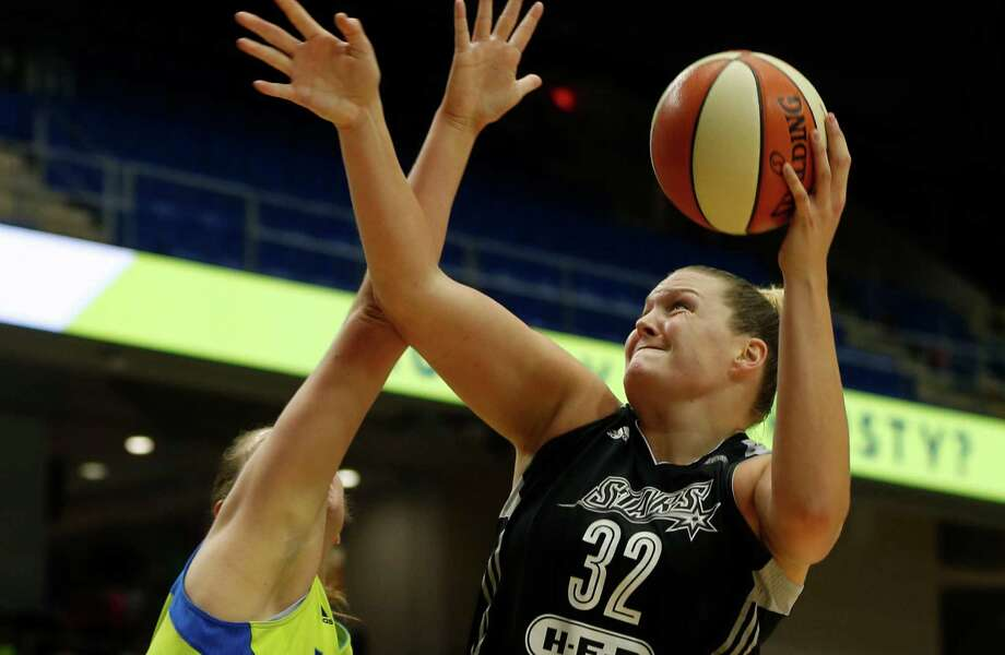 San Antonio Stars center Jayne Appel-Marinelli lays up a shot against Dallas Wings forward Theresa Plaisance during the second quarter of a WNBA game in Arlington on June 23, 2016. Photo: Rose Baca /Associated Press / The Dallas Morning News