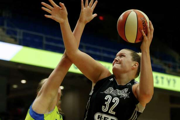 San Antonio Stars center Jayne Appel-Marinelli lays up a shot against Dallas Wings forward Theresa Plaisance during the second quarter of a WNBA game in Arlington on June 23, 2016.