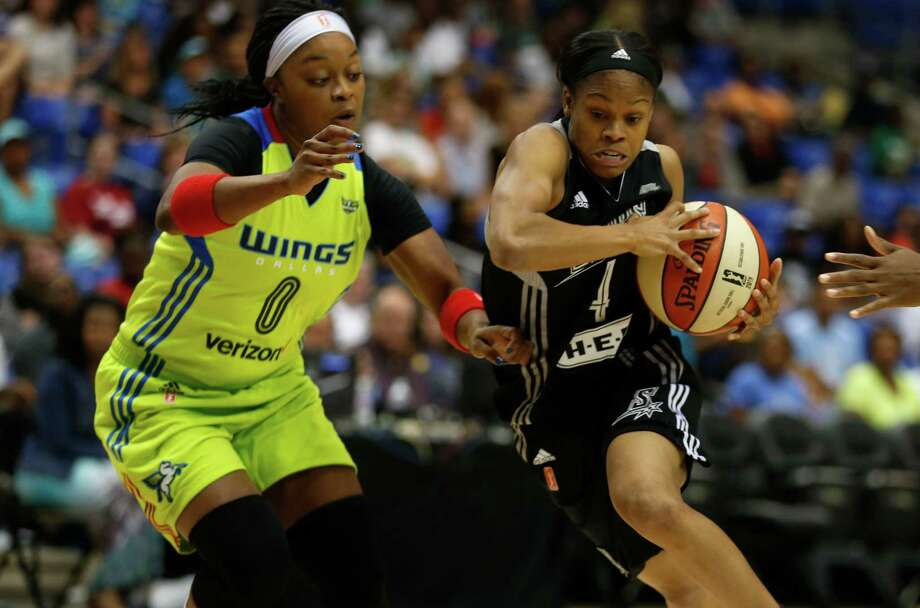 San Antonio Stars guard Moriah Jefferson (right) moves the ball around Dallas Wings guard Odyssey Sims during the first quarter of a WNBAgame in Arlington on June 23, 2016. Photo: Rose Baca /Associated Press / The Dallas Morning News