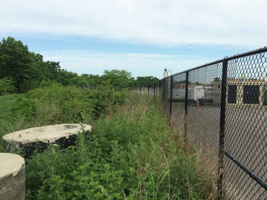 This is the vacant strip behind the Stratford Waste Treatment Plant where a dog park will likely be situated. It's adjacent to the town's animal shelter. Photo: John Burgeson / Connecticut Post