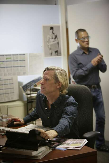 Scott Wazlowski (front), vice president of advertising, and Michael Yamashita work at the Bay Area Reporter office downtown. Photo: Lea Suzuki, The Chronicle