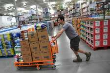 Seth Rubin, owner of Rise and Shine Biscuit Kitchen and Cafe, shops at the new Costco Business Center in Denver, June 01, 2016. The Costco Business Center is smaller than a typical Costco and features items geared specifically toward business customers. The facility is one of only a dozen nationwide.