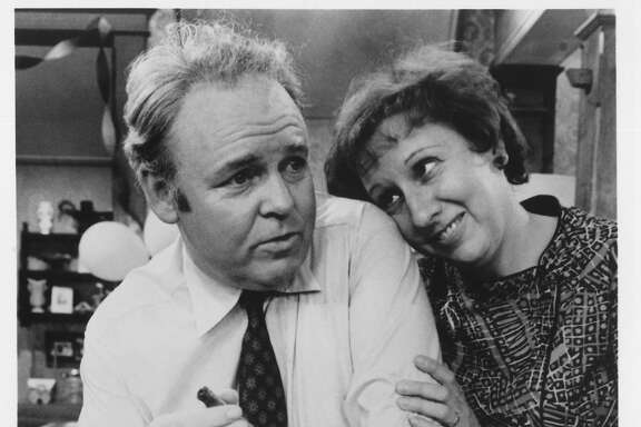 "JUN 12, 1991.  Carroll O'Connor and Jean Stapleton star as Archie and Edith Bunker on the landmark series ALL IN THE FAMILY, which returns to television Sunday, June 2 (8:30-9:00 PM, ET/PT) on the CBS Televison Network for six episodes. The series will follow SUNDAY DINNER (8:00-8:30 PM, ET/PT), Norman Lear's latest comedy entry, on the CBS Television Network.   HOUCHRON CAPTION (01/02/2000):  ""All in the Family"" - 1971-1979.   HOUCHRON CAPTION (12/25/2000): Carroll O'Connor and Jean Stapleton, in left photo, starred as Archie and Edith Bunker in the breakthrough sitcom All in the Family (1971-79).   HOUCHRON CAPTION (03/11/2002):  Archie Bunker, who was played by Carroll O'Connor, makes a good case for home ownership."