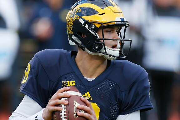 ANN ARBOR, MI - APRIL 01: John O'Korn #8 of the Michigan Wolverines throws a pass during the Michigan Football Spring Game on April 1, 2016 at Michigan Stadium in Ann Arbor, Michigan.  (Photo by Gregory Shamus/Getty Images)