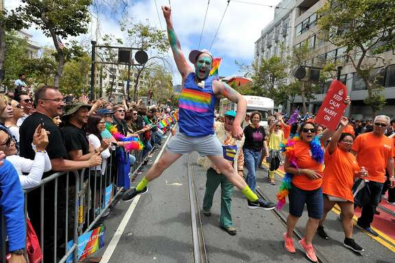 Benj Curtis jumps for joy during the annual Gay Pride Parade in San Francisco, California on June 28, 2015, two days after  the US Supreme Court's landmark ruling legalizing same-sex marriage nationwide.    AFP PHOTO / JOSH EDELSONJosh Edelson/AFP/Getty Images