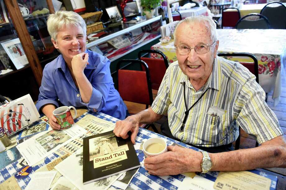 """Laura Schore, left, with Everett Rau, both of Altamont, on Tuesday, June 14, 2016, at the Home Front Cafe in Altamont, N.Y. Schore wrote """"Stand Tall Against the Odds,"""" a story of Rau's life (Cindy Schultz / Times Union) Photo: Cindy Schultz / Albany Times Union"""