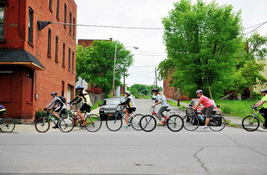 Bicyclists make their way along River Street during the family-friendly Cycle the Sam Bike Ride on Sunday, May 22, 2016, in Troy, N.Y.  The rides are put on by Capital Roots and Troy Bike Rescue.  Riders on Sunday traveled along the Uncle Sam Bikeway and sections of the bike trail in Waterford, Cohoes and Green Island before returning to Capital Roots.  The groups will host another ride on September 24th in conjunction with the Collar City Ramble, an alternative transportation festival hosted by Transport Troy.  (Paul Buckowski / Times Union) Photo: PAUL BUCKOWSKI / 10036260A