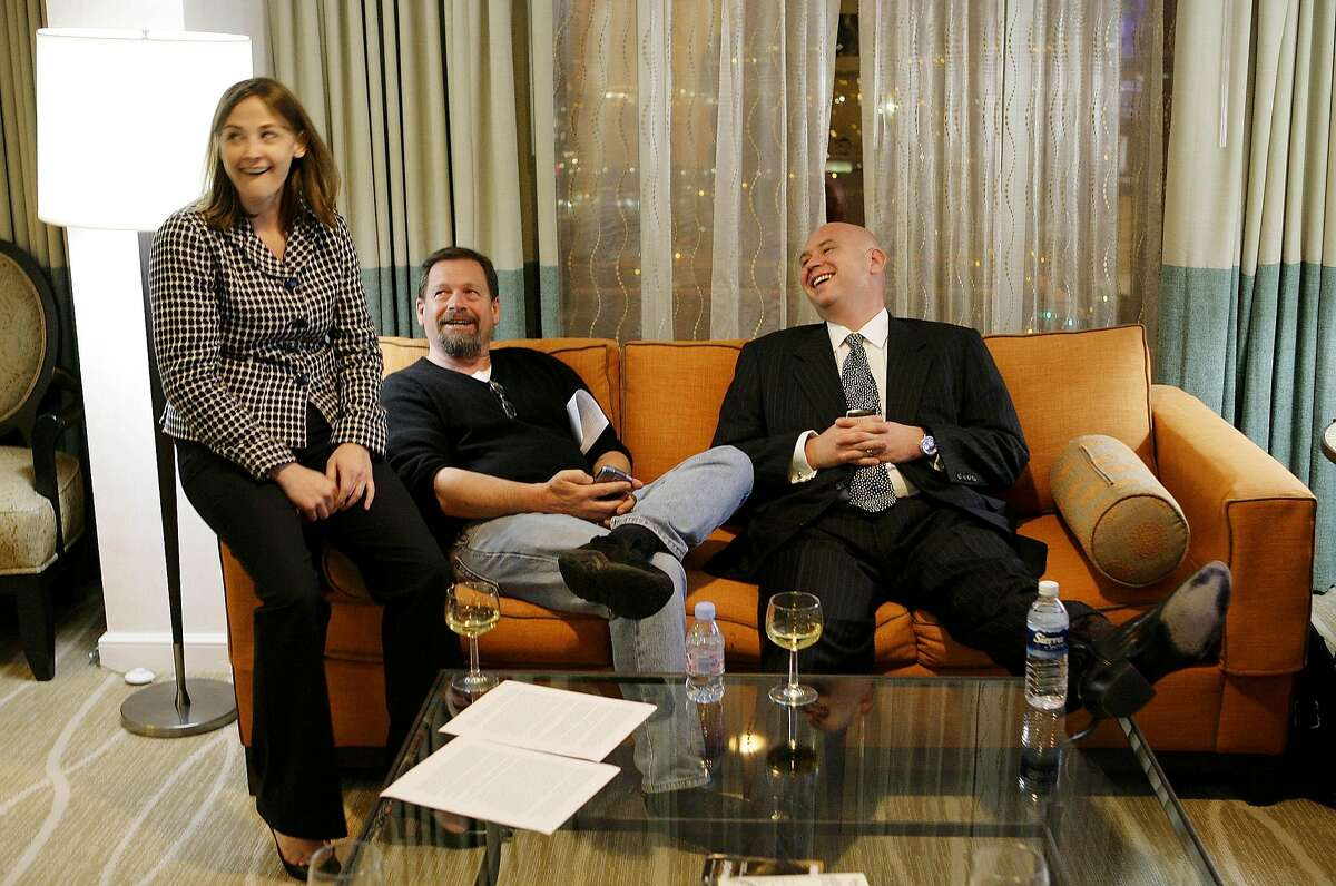 Republican presidential hopeful Sen. John McCain's, R-Ariz., press secretary Brooke Buchanan, left, and senior advisers Mark Salter, center, and Steve Schmidt, right, enjoy the moment after the announcement that McCain won enough delegates to be named the Republican presidential nominee in Dallas, Tuesday, March 4, 2008. (AP Photo/Stephan Savoia)