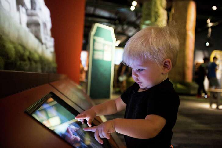 "Archer Moulton, 1, plays with a interactive touch screen within the ""Maya"" exhibit at the Witte Museum in San Antonio, on Tuesday, June 21, 2016."