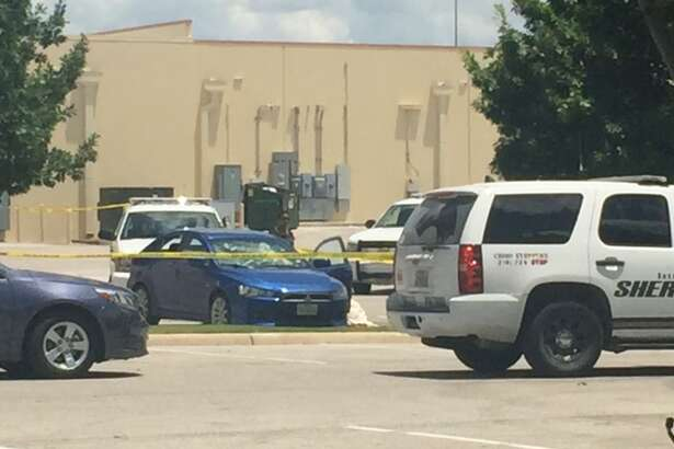 Bexar County authorities investigate the scene behind the Target near Highway 151 and Culebra after a man who caused a lockdown at Port San Antonio Friday, June 24, 2016, killed himself.