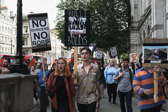 LONDON, ENGLAND- JUNE 24:   Young protesters walk towards Downing Street to protest against the United Kingdom's decision to leave the EU following the referendum on June 24, 2016 in London, United Kingdom. The United Kingdom has gone to the polls to decide whether or not the country wishes to remain within the European Union. After a hard fought campaign from both REMAIN and LEAVE the vote is too close to call. A result on the referendum is expected on Friday morning.  (Photo by Mary Turner/Getty Images)