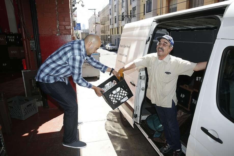 Dispatcher James Vilchez (left) and driver Otto Baltodano (right) unload the truck used to send meals to the elderly from Project Open Hand on Friday, June 24, 2016, in San Francisco, Calif. Photo: Liz Hafalia, The Chronicle