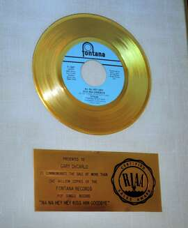 "A gold record awarded to Gary DeCarlo, who wrote the 1969 number one hit ""Na Na Hey Hey Kiss Him Goodbye"" hangs in the practice space at his home in Shelton, Conn., on Wednesday June 15, 2016."