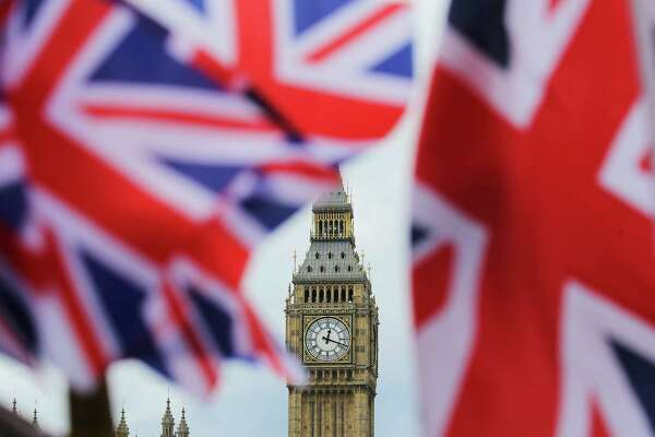 The British nationals flag flies in front of the Big Ben clock tower on June 24, 2016 in London. In a referendum the day before, Britons voted by a narrow margin to leave the European Union (EU). (Michael Kappeler/DPA/Zuma Press/TNS)