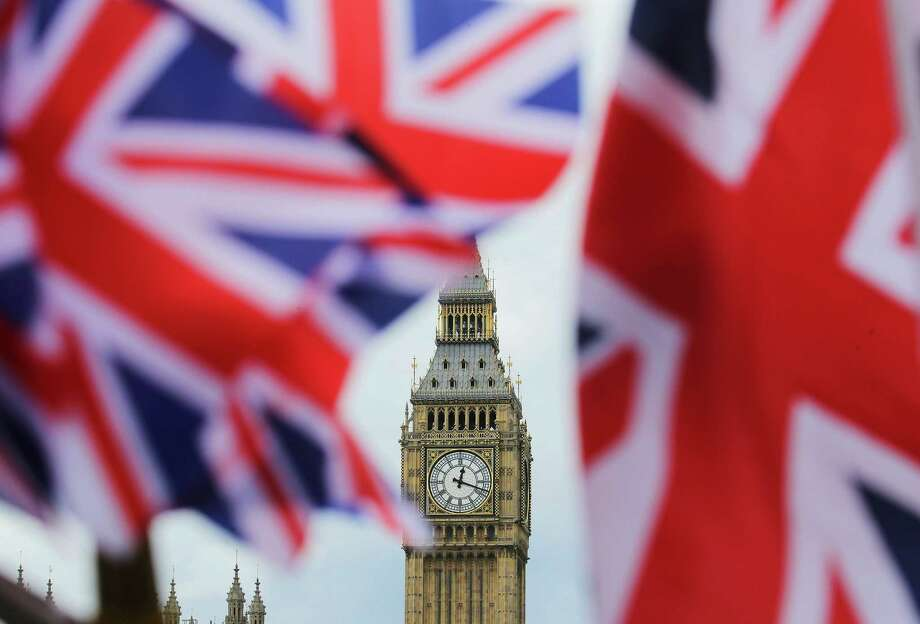 The British nationals flag flies in front of the Big Ben clock tower on June 24, 2016 in London. In a referendum the day before, Britons voted by a narrow margin to leave the European Union (EU). (Michael Kappeler/DPA/Zuma Press/TNS) Photo: Michael Kappeler/DPA, MBR / Zuma Press