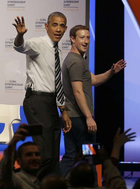 President Obama and Facebook founder Mark Zuckerberg leave the stage after speaking to entrepreneurs on campus. Photo: Jeff Chiu, Associated Press