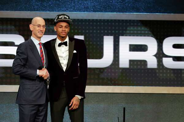 Dejounte Murray poses for a photo with NBA Commissioner Adam Silver after being selected 29th overall by the San Antonio Spurs during the NBA basketball draft, Thursday, June 23, 2016, in New York. (AP Photo/Frank Franklin II)