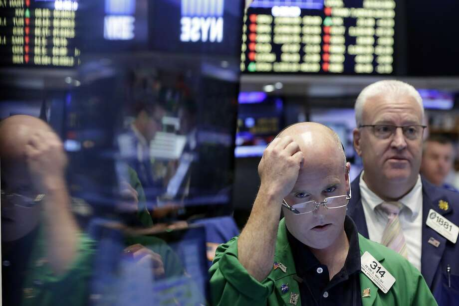 Traders at the New York Stock Exchange surveyed the damage Friday after the British vote to withdraw from the European Union. Photo: Richard Drew, Associated Press