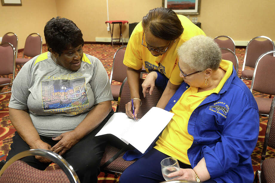 From left, Rosie Citizen, Gwendolyn Scott Walters, and Carolyn Simon look through alumni information as board members of the Hebert High School Alumni gather at the Holiday Inn in Beaumont to continue preparations for the 11th Mass Reunion celebration, which begins June 29 and runs through July 3. The event is expected to draw 800 people, with spending projected over half a million dollars. Although the school closed in 1982, its spirit is well alive, and is one of the best attended high school reunion events in Beaumont. Photo taken Thursday, June 16, 2016 Kim Brent/The Enterprise Photo: Kim Brent / Beaumont Enterprise