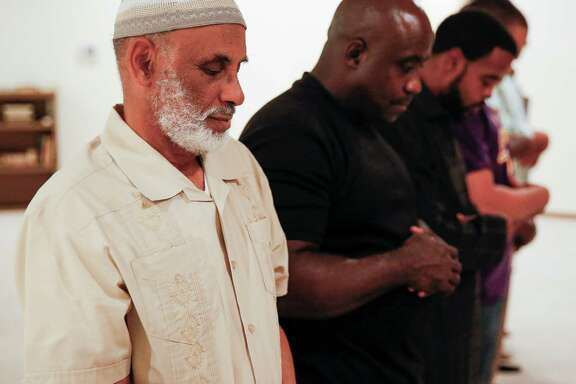 Haywood Shakir Talib prays before breaking fast during Ramadan at Masjid Warithud-deen Mohammed, Houston's oldest mosque, Monday, June 20, 2016 in Houston.