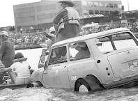 Participants float aboard a car during the 1986 Neches River Raft Race. Enterprise archive photo