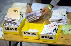 FILE - In this Friday, June 24, 2016 file photo, votes are sorted into remain, leave and doubtful trays as ballots are counted during the EU Referendum count for Westminster and the City of London at the Lindley Hall in London. (Anthony Devlin/PA via AP, File) UNITED KINGDOM OUT NO SALES NO ARCHIVE
